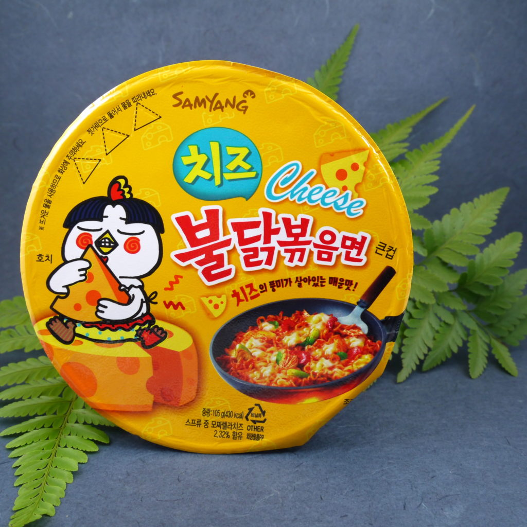 The packaging of this cup of spicy ramen or (ramyun in Korean, 라면) is deceptively cheerful. For non-Korean speakers, a cartoon of a chicken nibbling away ...